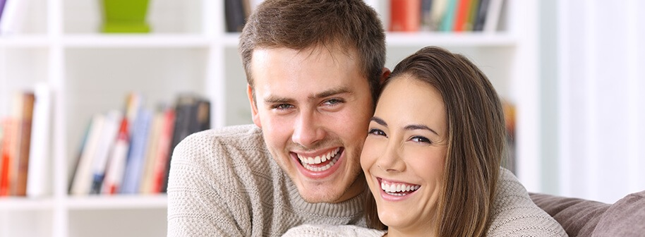 happy young couple with beautiful smiles
