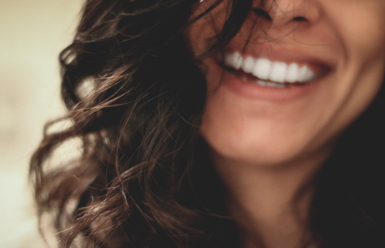 woman's beautiful smile from porcelain veneers